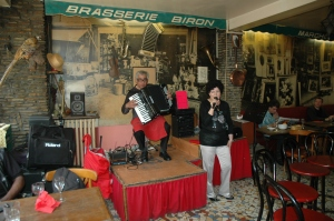 The accordion player and singer at the little Brasserie Biron Paris