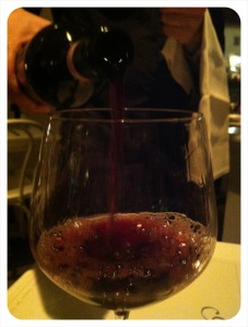 Wine being poured at the Golden View Restaurant