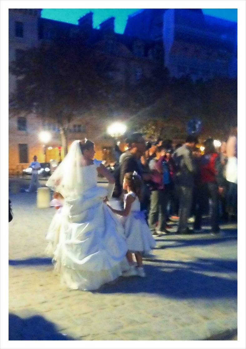 Bride and her flower girl at the Notre Dame Cathedral in Paris
