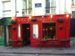 Darling cafe at the bottom of massive set of stair in Montmartre Paris