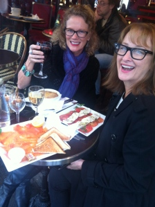 Sandy and Judy enjoying the cool and the rain in Paris with their typical lunch
