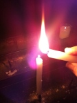 lighting a candle for my loved ones who have left this world