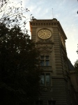 a watchtower with a golden clock on the Boulevard St. Germain des Pres