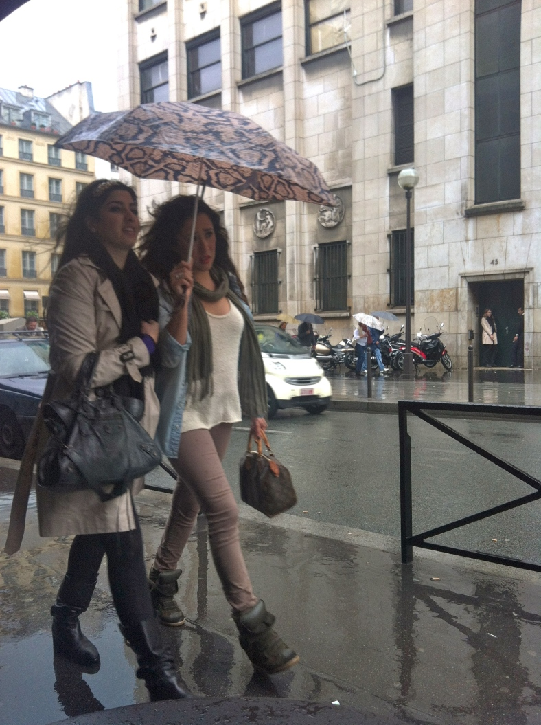 Rain does not stop the Parisians - you just stop for cafe!