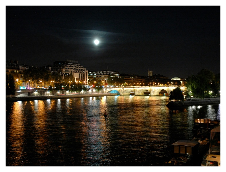 moon over the river Seine in Paris